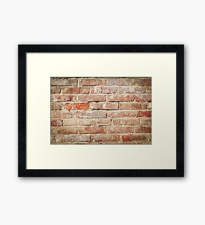 Weathered stained old brick wall  Framed Print