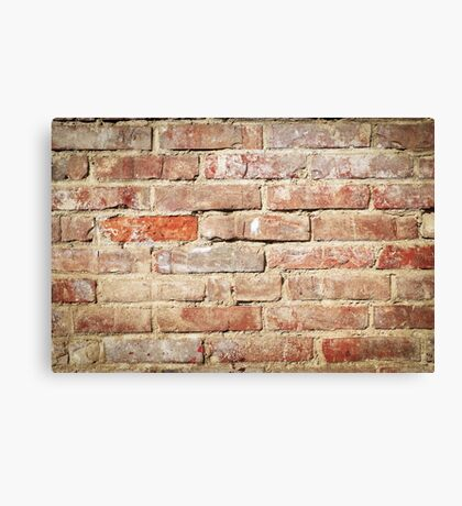 Weathered stained old brick wall  Canvas Print