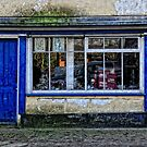 Old shop front. by Karen  Betts