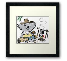 Cartoon koala bear sitting by campfire in outback Framed Print