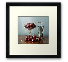 Cherries on a silver plate and an ancient glass Framed Print