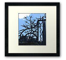 Ironwork spikes on blue sky Framed Print