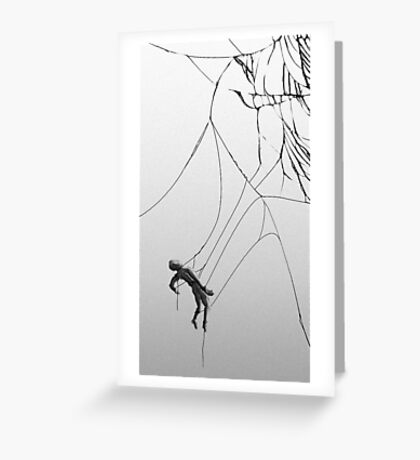 Man hanging from cracked display Greeting Card