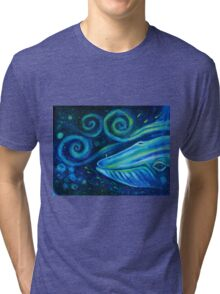 Big blue whale into the space of Universe with silhouette of man. Tri-blend T-Shirt