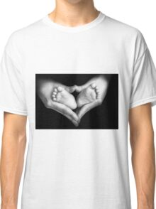 Baby feet in the mother hands Classic T-Shirt