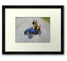 Cat In Toy Car Framed Print