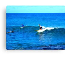 Surfers on Oahu's North Shore Canvas Print