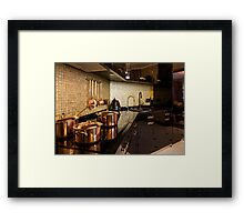 copper pans on the stove Framed Print