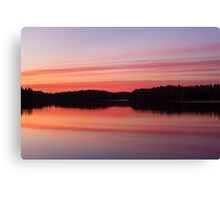 Serene view of calm lake and tree silhouettes Canvas Print