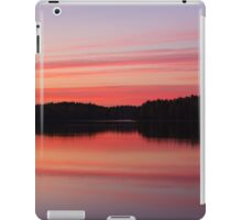 Serene view of calm lake and tree silhouettes iPad Case/Skin