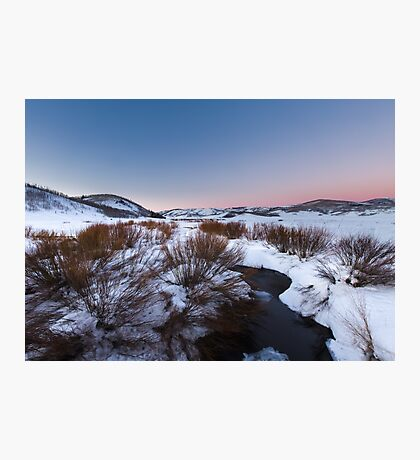 River Flowing in snow field sunset Photographic Print