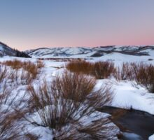 River Flowing in snow field sunset Sticker