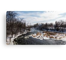 Mill on a river in winter Canvas Print