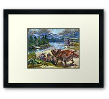 Herd of triceratopses is walking to a river Framed Print