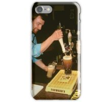 Landlord serving pints of beer, UK, 1980s. iPhone Case/Skin