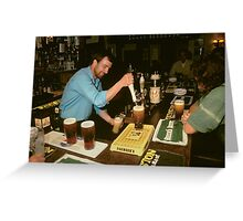 Landlord serving pints of beer, UK, 1980s. Greeting Card
