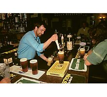 Landlord serving pints of beer, UK, 1980s. Photographic Print