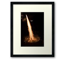 Fireworks rocket being launched out of a champagne bottle on its way into the sky Framed Print