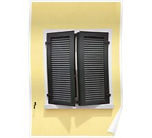 Partly opened green window shutters on bright yellow wall with great shadows Poster
