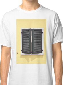 Partly opened green window shutters on bright yellow wall with great shadows Classic T-Shirt