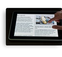 Modern Tablet PC displaying news with hand touching the display Canvas Print