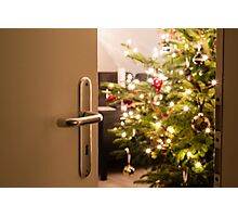 Interior shot of a modern living room with a Christmas tree as seen through the living room door Photographic Print