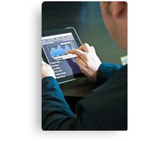 Closeup of a businessman accessing his digital tablet PC Canvas Print
