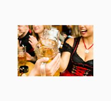 Bavarian girls in traditional Dirndl dresses are drinking beer and having fun at the Oktoberfest Unisex T-Shirt