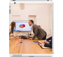 Conflict in the office : Business woman arguing with her boss at meeting over latest sales figures with others watching embarassed iPad Case/Skin