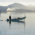 fisherman on Lago Trasimeno, San Feliciano, Umbria, Italy by Andrew Jones