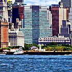 Tugboat Pushing Barge Near Manhattan Skyline by Susan Savad