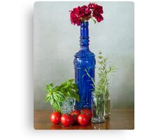 Blue glass bottle with vegetables and flowers Canvas Print