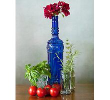 Blue glass bottle with vegetables and flowers Photographic Print
