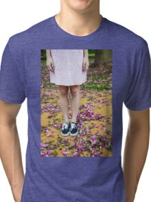 young girl in a park with purple flowers on floor Tri-blend T-Shirt