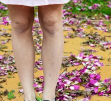 young girl in a park with purple flowers on floor Sticker