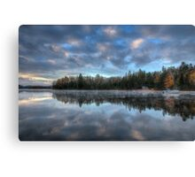 Reflected trees and sky Canvas Print