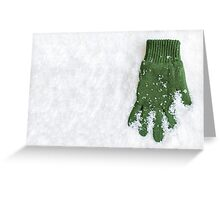 Glove Laying in Snow Greeting Card