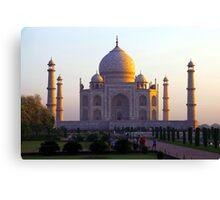 The Taj Mahal catches the sun at sunrise Canvas Print