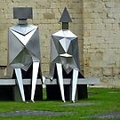 Mathematical figures on a pew by Arie Koene