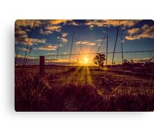 Sunset through the fenceline Canvas Print