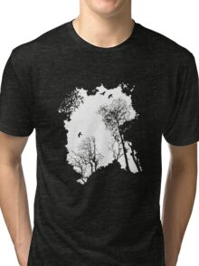 White forest silhouette on a range of backgrounds Tri-blend T-Shirt