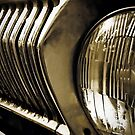 Old classic car headlight by Nhan Ngo
