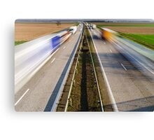 Blurred vehicles driving on motorway in France, rural landscape Canvas Print