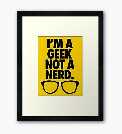 I'M A GEEK NOT A NERD. Framed Print