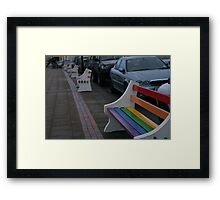 Colourful benches on a dull day Framed Print