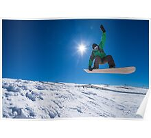 Snowboarder jumping against blue sky Poster