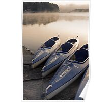 Kayak canoe boats at lake shore in morning fog Poster