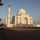 The Taj Mahal as the sun rises. by John Dalkin