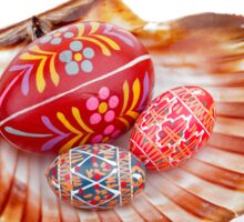 hand painted easter eggs on big shell on white table Sticker