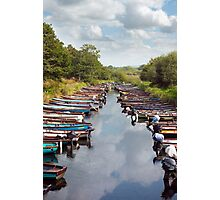rowing boats moored at ross castle Photographic Print
